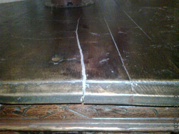 improperly repaired crack in antique Chinese table